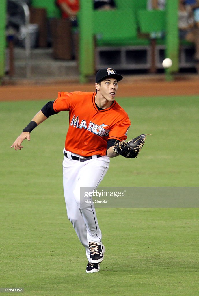 Outfielder Christian Yelich #21 of the Miami Marlins makes a running catch against the Colorado Rockies at Marlins Park on August 25, 2013 in Miami, Florida.