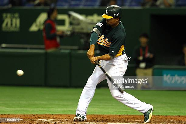 Outfielder Coco Crisp of Oakland Athletics hits a double during the top half of the fourth inning in the pre season game between Oakland Athletics...
