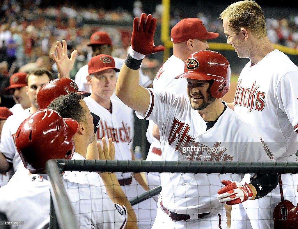 Outfielder <a gi-track='captionPersonalityLinkClicked' href=/galleries/search?phrase=Cody+Ross&family=editorial&specificpeople=545810 ng-click='$event.stopPropagation()'>Cody Ross</a> #7 of the Arizona Diamondbacks celebrates with teammates in the dugout after hitting a three run home run against the Tampa Bay Rays in the fourth inning at Chase Field on August 6, 2013 in Phoenix, Arizona. The Diamondbacks defeated the Rays 6-1.