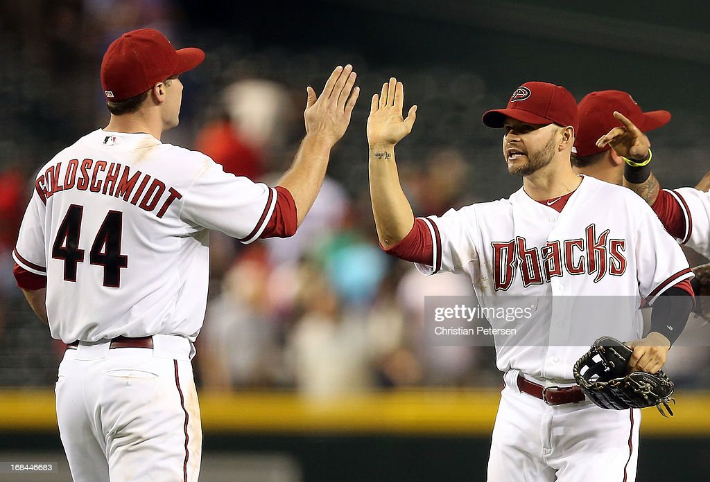 Outfielder <a gi-track='captionPersonalityLinkClicked' href=/galleries/search?phrase=Cody+Ross&family=editorial&specificpeople=545810 ng-click='$event.stopPropagation()'>Cody Ross</a> #7 of the Arizona Diamondbacks high fives infielder <a gi-track='captionPersonalityLinkClicked' href=/galleries/search?phrase=Paul+Goldschmidt&family=editorial&specificpeople=7511120 ng-click='$event.stopPropagation()'>Paul Goldschmidt</a> #44 after defeating the Philadelphia Phillies in the MLB game at Chase Field on May 9, 2013 in Phoenix, Arizona. The Diamondbacks defeated the Phillies 2-1.