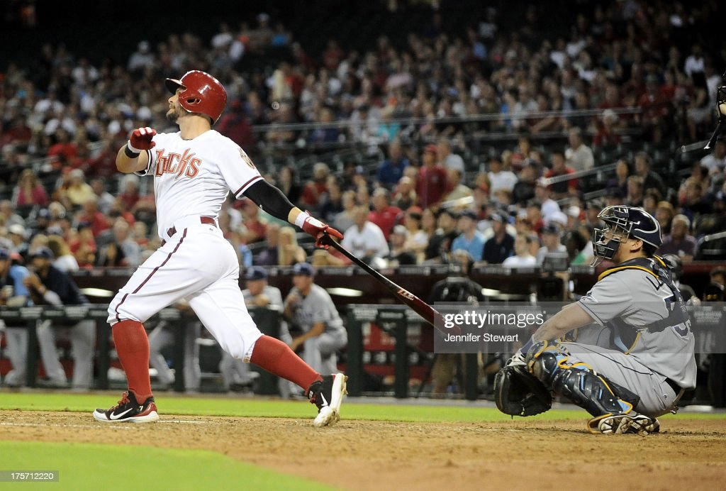 Outfielder <a gi-track='captionPersonalityLinkClicked' href=/galleries/search?phrase=Cody+Ross&family=editorial&specificpeople=545810 ng-click='$event.stopPropagation()'>Cody Ross</a> #7 of the Arizona Diamondbacks hits a three-run home run against the Tampa Bay Rays in the fourth inning at Chase Field on August 6, 2013 in Phoenix, Arizona. The Diamondbacks defeated the Rays 6-1.