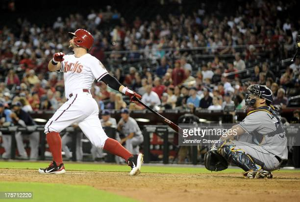 Outfielder Cody Ross of the Arizona Diamondbacks hits a threerun home run against the Tampa Bay Rays in the fourth inning at Chase Field on August 6...