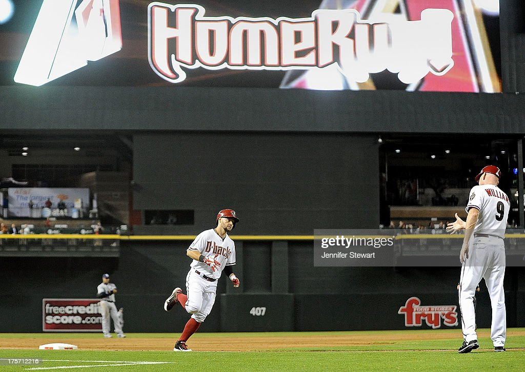 Outfielder <a gi-track='captionPersonalityLinkClicked' href=/galleries/search?phrase=Cody+Ross&family=editorial&specificpeople=545810 ng-click='$event.stopPropagation()'>Cody Ross</a> #7 of the Arizona Diamondbacks rounds third base after hitting a three run home run against the Tampa Bay Rays in the fourth inning at Chase Field on August 6, 2013 in Phoenix, Arizona. The Diamondbacks defeated the Rays 6-1.