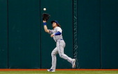 Outfielder Colby Rasmus of the Toronto Blue Jays catches a fly ball against the Tampa Bay Rays during the game at Tropicana Field on September 23...