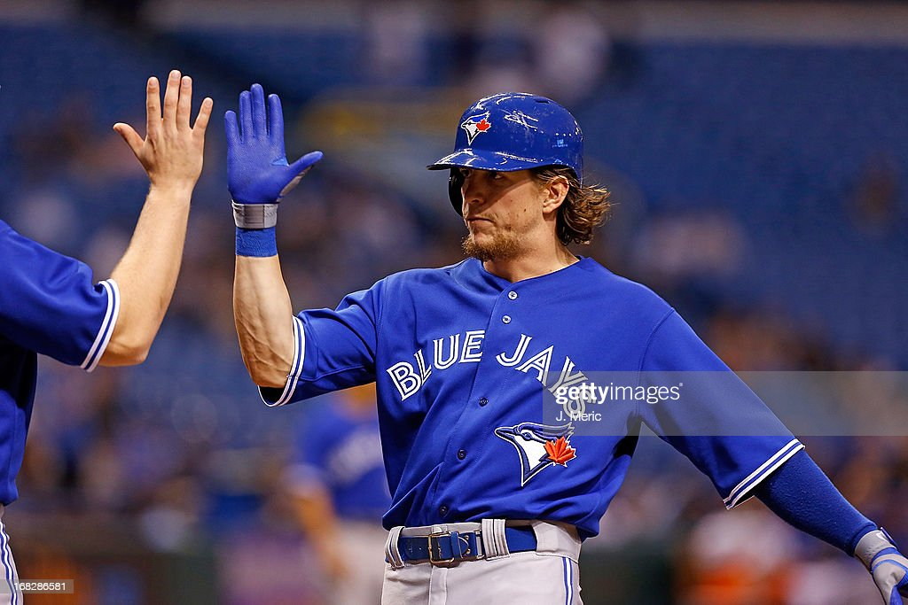 Outfielder <a gi-track='captionPersonalityLinkClicked' href=/galleries/search?phrase=Colby+Rasmus&family=editorial&specificpeople=3988372 ng-click='$event.stopPropagation()'>Colby Rasmus</a> #28 of the Toronto Blue Jays is congratulated after his home run against the Tampa Bay Rays during the game at Tropicana Field on May 7, 2013 in St. Petersburg, Florida.