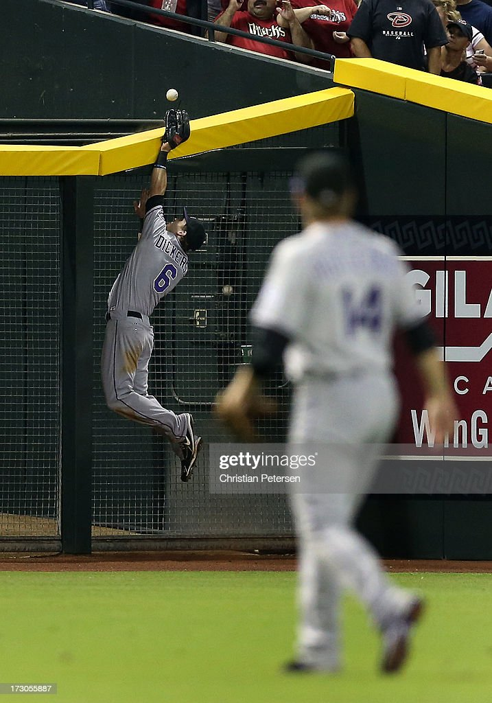 Outfielder Corey Dickerson #6 of the Colorado Rockies attempts to make a leaping catch on a double hit by A.J. Pollock (not pictured) of the Arizona Diamondbacks during the third inning of the MLB game at Chase Field on July 5, 2013 in Phoenix, Arizona.