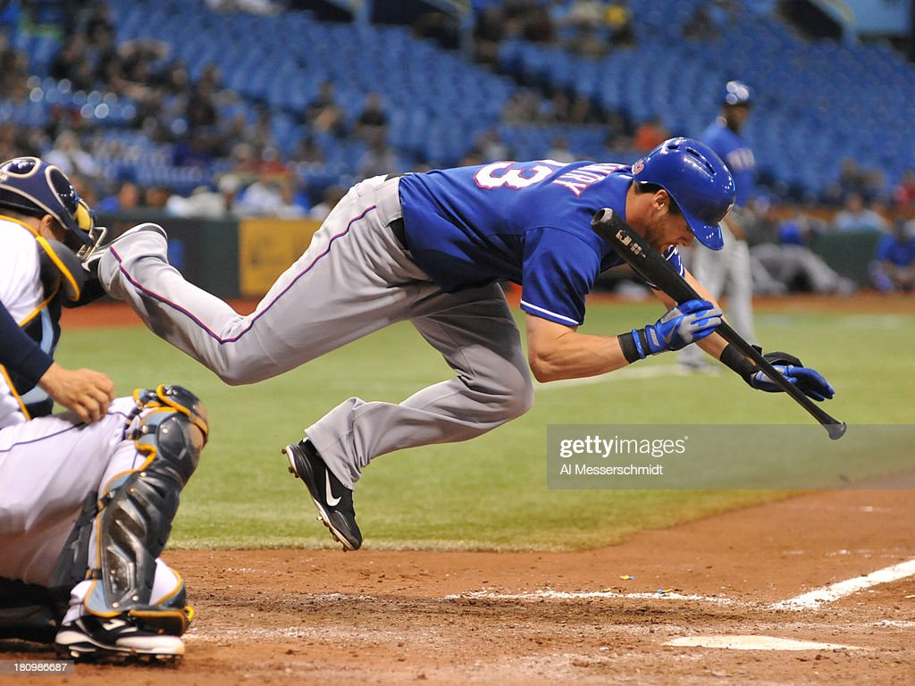 Outfielder <a gi-track='captionPersonalityLinkClicked' href=/galleries/search?phrase=Craig+Gentry&family=editorial&specificpeople=6352553 ng-click='$event.stopPropagation()'>Craig Gentry</a> #23 of the Texas Rangers dives away from an inside pitch against the Tampa Bay Rays September 18, 2013 at Tropicana Field in St. Petersburg, Florida. The Rays won 4 - 3.