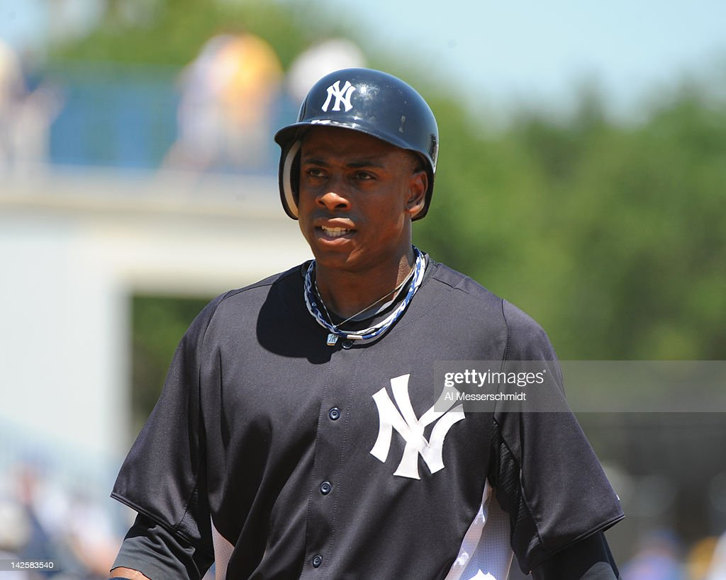 Outfielder Curtis Granderson #14 of the New York Yankees leads off first base against the New York Mets in a spring training game April 4, 2012 at George M. Steinbrenner Field in Tampa, Florida.