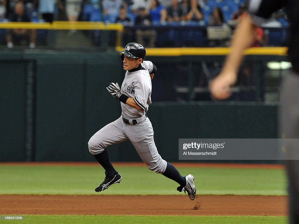 Outfielder Curtis <a gi-track='captionPersonalityLinkClicked' href=/galleries/search?phrase=Ichiro+Suzuki&family=editorial&specificpeople=201556 ng-click='$event.stopPropagation()'>Ichiro Suzuki</a> #31 of the New York Yankees runs to third base for a triple against the Tampa Bay Rays May 26, 2013 at Tropicana Field in St. Petersburg, Florida. The Rays won 8 - 3.
