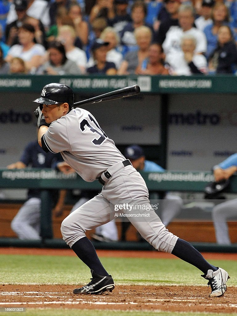 Outfielder Curtis <a gi-track='captionPersonalityLinkClicked' href=/galleries/search?phrase=Ichiro+Suzuki&family=editorial&specificpeople=201556 ng-click='$event.stopPropagation()'>Ichiro Suzuki</a> #31 of the New York Yankees triples against the Tampa Bay Rays May 26, 2013 at Tropicana Field in St. Petersburg, Florida. The Rays won 8 - 3.