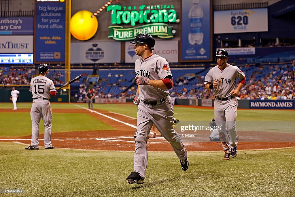 Outfielder <a gi-track='captionPersonalityLinkClicked' href=/galleries/search?phrase=Daniel+Nava&family=editorial&specificpeople=670454 ng-click='$event.stopPropagation()'>Daniel Nava</a> #29 of the Boston Red Sox celebrates his two run home run against the Tampa Bay Rays during the game at Tropicana Field on June 12, 2013 in St. Petersburg, Florida.