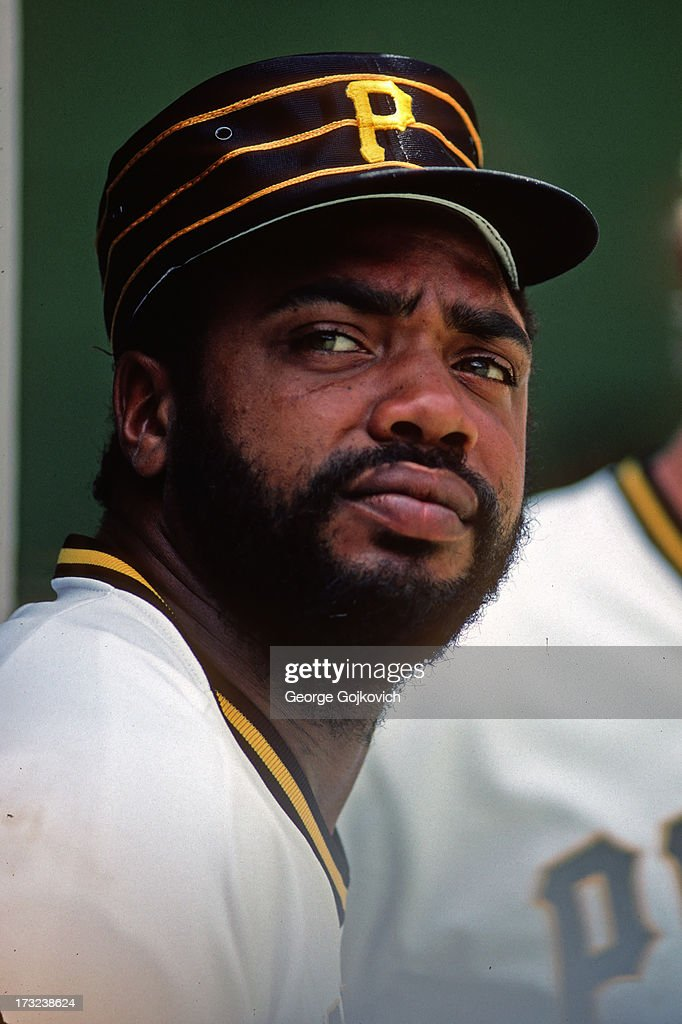 Outfielder Dave Parker of the Pittsburgh Pirates looks on from the dugout during a Major League Baseball game at Three Rivers Stadium circa 1980 in...