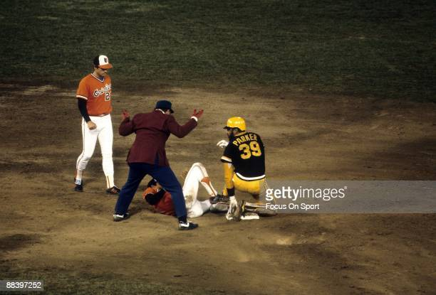 Outfielder Dave Parker slides into second base with Baltimore Orioles shortstop Mark Belanger covering during a 1979 World Series game between the...