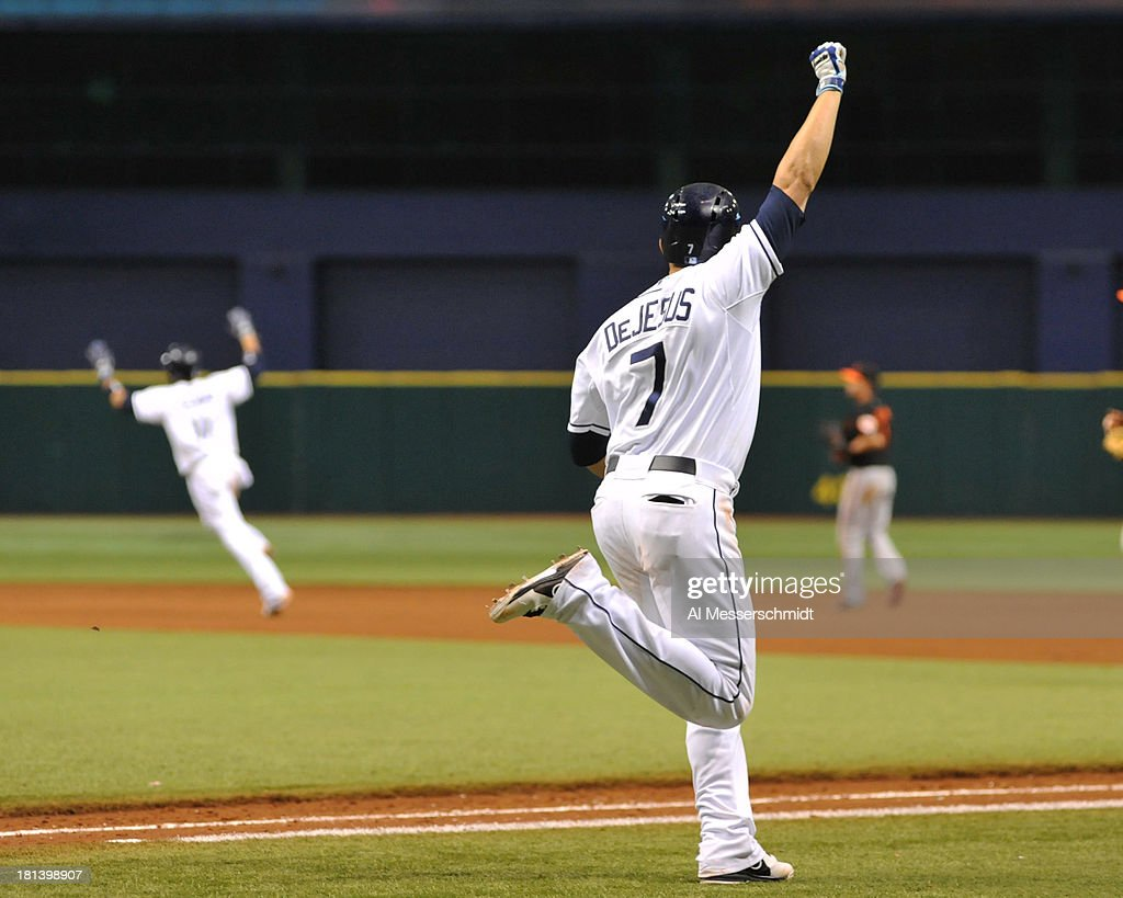 Outfielder <a gi-track='captionPersonalityLinkClicked' href=/galleries/search?phrase=David+DeJesus&family=editorial&specificpeople=206765 ng-click='$event.stopPropagation()'>David DeJesus</a> #7 of the Tampa Bay Rays pumps his fist after a single in the 18th inning to drive in the winning run against the Baltimore Orioles September 20, 2013 at Tropicana Field in St. Petersburg, Florida. The Rays won 5 - 4.