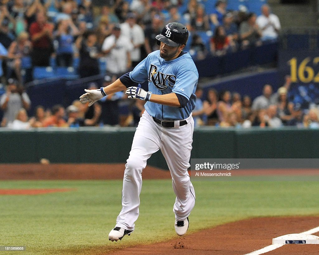 Outfielder David DeJesus #7 of the Tampa Bay Rays rounds 3rd base after a 1st inning, leadoff home run against the Baltimore Orioles September 22, 2013 at Tropicana Field in St. Petersburg, Florida.