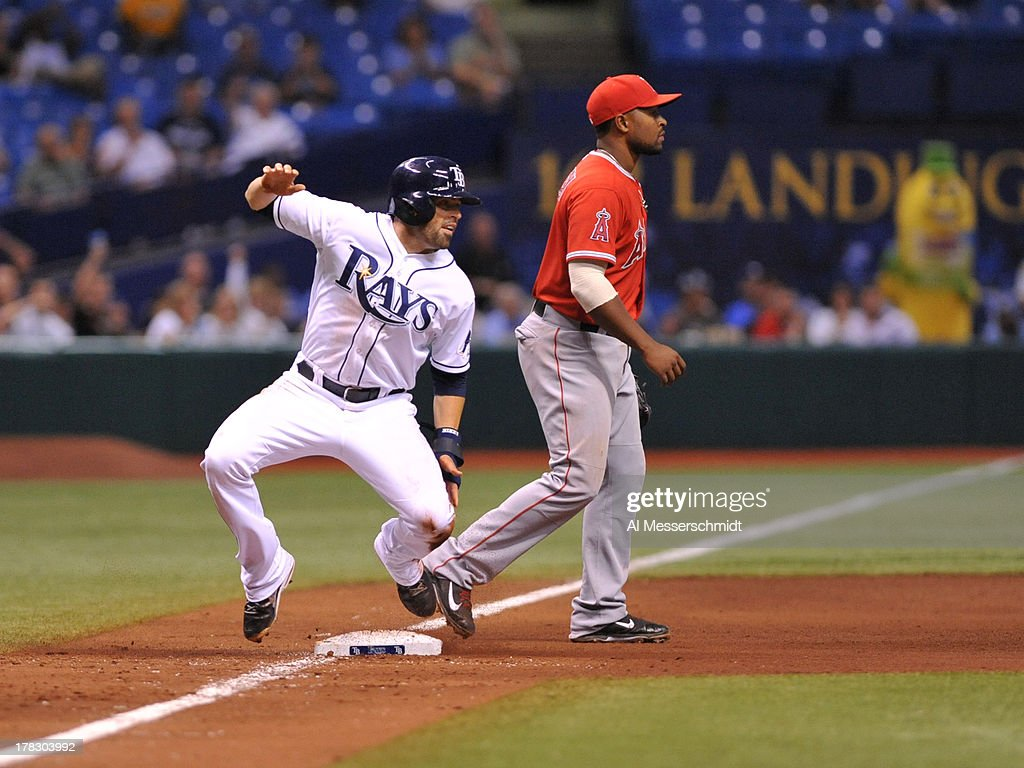 Outfielder <a gi-track='captionPersonalityLinkClicked' href=/galleries/search?phrase=David+DeJesus&family=editorial&specificpeople=206765 ng-click='$event.stopPropagation()'>David DeJesus</a> #7 of the Tampa Bay Rays slides into 3rd base against the Los Angeles Angels of Anaheim of Anaheim August 28, 2013 at Tropicana Field in St. Petersburg, Florida. The Rays won 4 - 1.