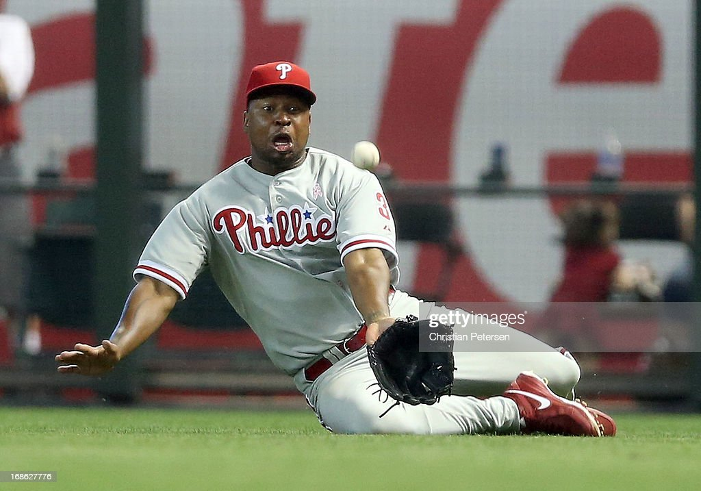Outfielder <a gi-track='captionPersonalityLinkClicked' href=/galleries/search?phrase=Delmon+Young&family=editorial&specificpeople=700362 ng-click='$event.stopPropagation()'>Delmon Young</a> #3 of the Philadelphia Phillies slides as he attempts to catch a single hit by Jason Kubel (not pictured) of the Arizona Diamondbacks during the seventh inning of the MLB game at Chase Field on May 12, 2013 in Phoenix, Arizona.