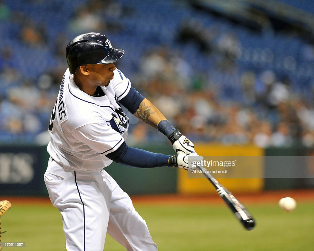Outfielder Desmond Jennings #8 of the Tampa Bay Rays bats against the Kansas City Royals June 13, 2013 at Tropicana Field in St. Petersburg, Florida.