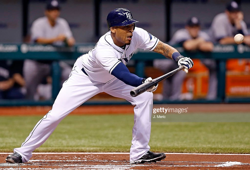 Outfielder <a gi-track='captionPersonalityLinkClicked' href=/galleries/search?phrase=Desmond+Jennings&family=editorial&specificpeople=5974085 ng-click='$event.stopPropagation()'>Desmond Jennings</a> #8 of the Tampa Bay Rays bunts against the New York Yankees during the game at Tropicana Field on September 5, 2012 in St. Petersburg, Florida.