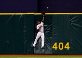 Outfielder Desmond Jennings of the Tampa Bay Rays cannot come up with this fly ball as it is over the centerfield fence against the Toronto Blue Jays...