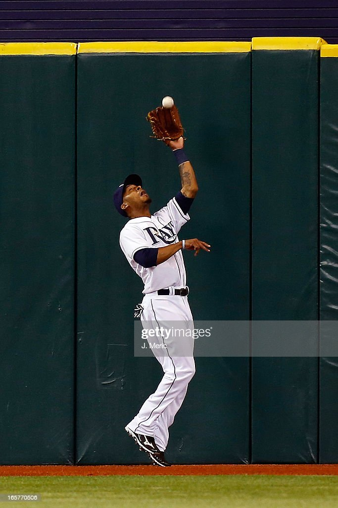 Outfielder <a gi-track='captionPersonalityLinkClicked' href=/galleries/search?phrase=Desmond+Jennings&family=editorial&specificpeople=5974085 ng-click='$event.stopPropagation()'>Desmond Jennings</a> #8 of the Tampa Bay Rays catches a first inning fly ball to deep center against the Cleveland Indians during the game at Tropicana Field on April 5, 2013 in St. Petersburg, Florida.