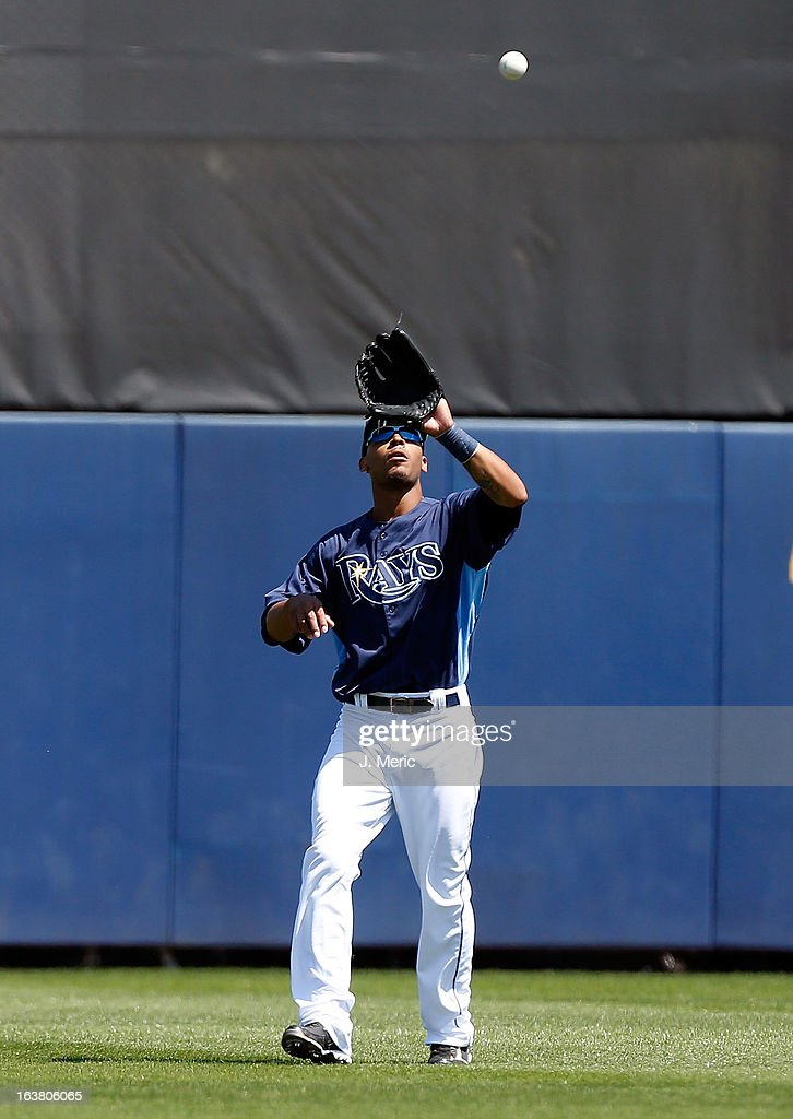 Outfielder <a gi-track='captionPersonalityLinkClicked' href=/galleries/search?phrase=Desmond+Jennings&family=editorial&specificpeople=5974085 ng-click='$event.stopPropagation()'>Desmond Jennings</a> #8 of the Tampa Bay Rays catches a fly ball against the Boston Red Sox during a Grapefruit League Spring Training Game at the Charlotte Sports Complex on March 16, 2013 in Port Charlotte, Florida.
