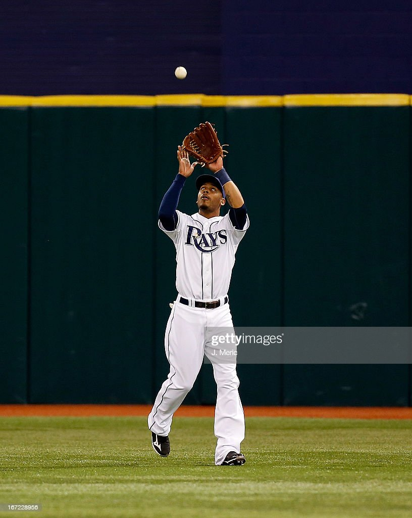 Outfielder <a gi-track='captionPersonalityLinkClicked' href=/galleries/search?phrase=Desmond+Jennings&family=editorial&specificpeople=5974085 ng-click='$event.stopPropagation()'>Desmond Jennings</a> #8 of the Tampa Bay Rays catches a fly ball against the New York Yankees during the game at Tropicana Field on April 22, 2013 in St. Petersburg, Florida.