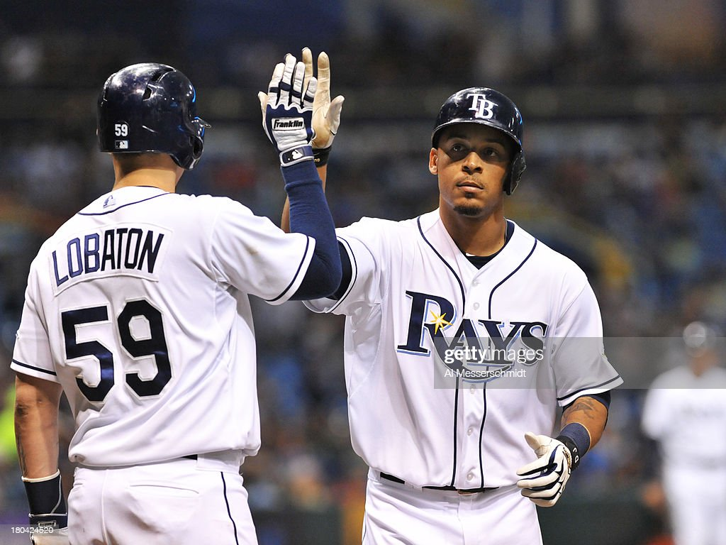 Outfielder Desmond Jennings #8 of the Tampa Bay Rays celebrates a fourth-inning home run with Jose Lobaton #59 against the Boston Red Sox September 12, 2013 at Tropicana Field in St. Petersburg, Florida.