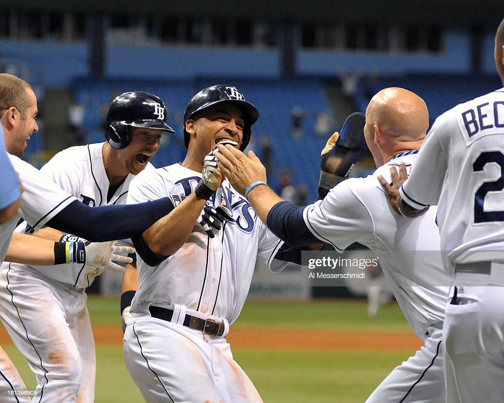 Outfielder Desmond Jennings #8 of the Tampa Bay Rays celebrates after scoring the winning run against the Baltimore Orioles September 20, 2013 at Tropicana Field in St. Petersburg, Florida. The Rays won 5 - 4 in 18 innings.