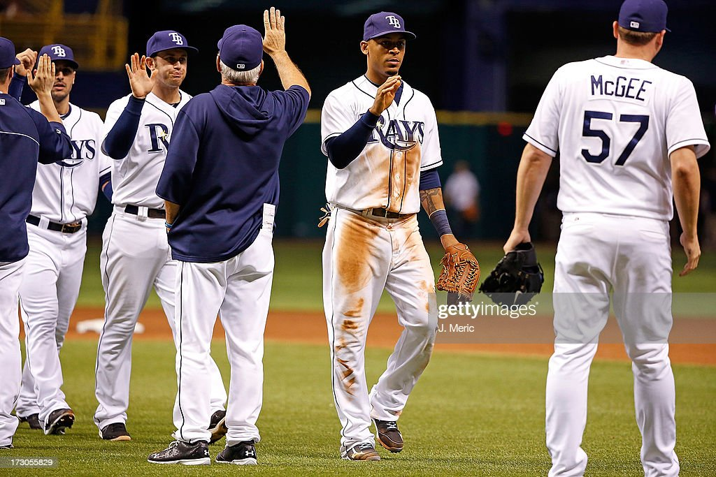 Outfielder <a gi-track='captionPersonalityLinkClicked' href=/galleries/search?phrase=Desmond+Jennings&family=editorial&specificpeople=5974085 ng-click='$event.stopPropagation()'>Desmond Jennings</a> #8 of the Tampa Bay Rays celebrates the Rays' victory over the Chicago White Sox at Tropicana Field on July 5, 2013 in St. Petersburg, Florida.