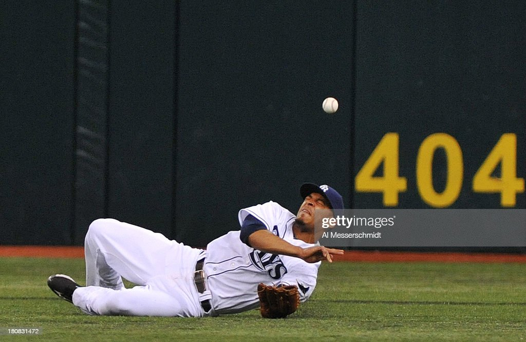 Outfielder <a gi-track='captionPersonalityLinkClicked' href=/galleries/search?phrase=Desmond+Jennings&family=editorial&specificpeople=5974085 ng-click='$event.stopPropagation()'>Desmond Jennings</a> #8 of the Tampa Bay Rays dives and misses a fly ball against the Texas Rangers September 16, 2013 at Tropicana Field in St. Petersburg, Florida. The Rays won 6 - 2.