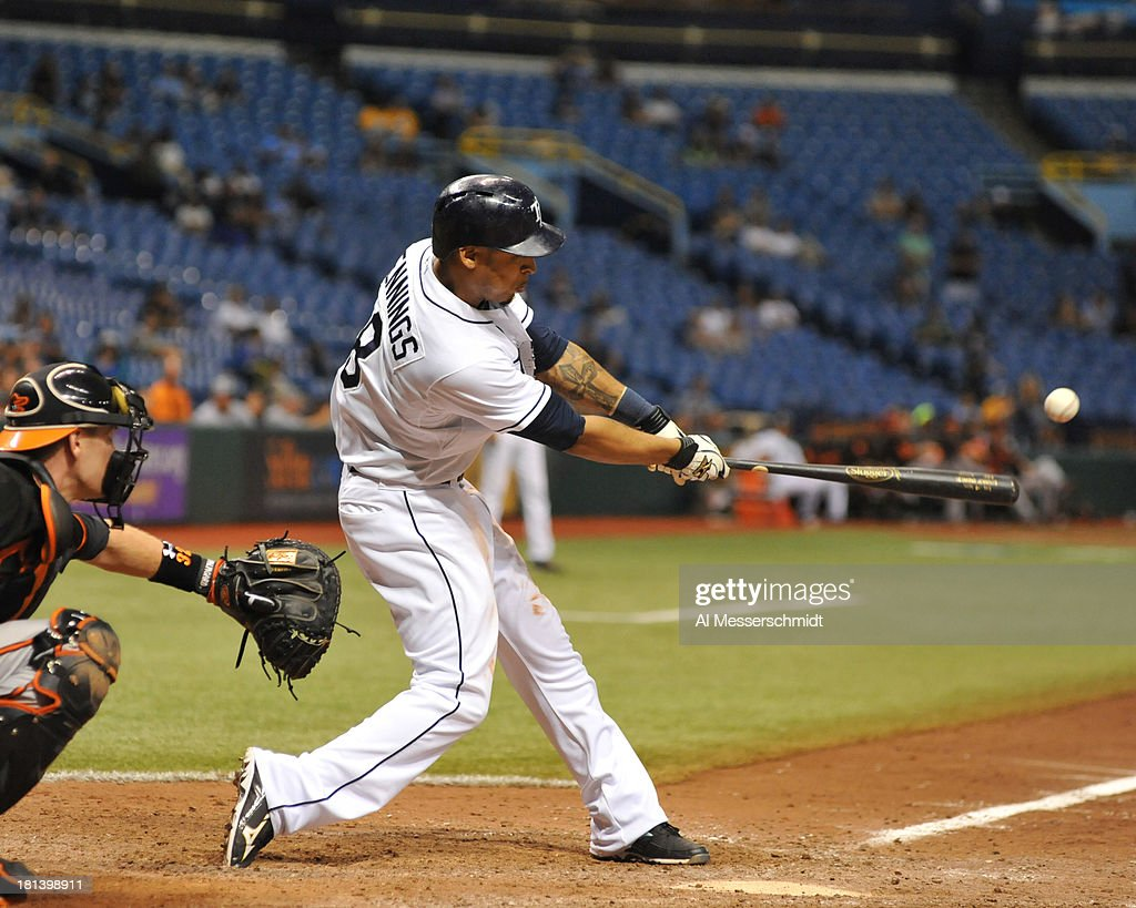 Outfielder <a gi-track='captionPersonalityLinkClicked' href=/galleries/search?phrase=Desmond+Jennings&family=editorial&specificpeople=5974085 ng-click='$event.stopPropagation()'>Desmond Jennings</a> #8 of the Tampa Bay Rays doubles in the 18th inning against the Baltimore Orioles September 20, 2013 at Tropicana Field in St. Petersburg, Florida. Jennings scored the winning run. The Rays won 5 - 4.
