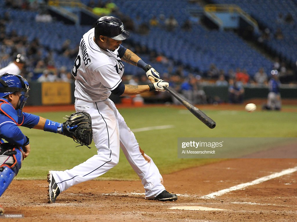 Outfielder <a gi-track='captionPersonalityLinkClicked' href=/galleries/search?phrase=Desmond+Jennings&family=editorial&specificpeople=5974085 ng-click='$event.stopPropagation()'>Desmond Jennings</a> #8 of the Tampa Bay Rays drives in the winning run in the 12th inning against the Texas Rangers September 18, 2013 at Tropicana Field in St. Petersburg, Florida. The Rays won 4 - 3.