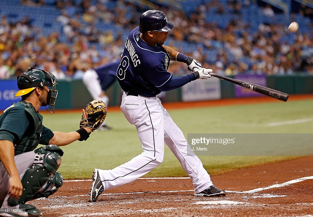 Outfielder <a gi-track='captionPersonalityLinkClicked' href=/galleries/search?phrase=Desmond+Jennings&family=editorial&specificpeople=5974085 ng-click='$event.stopPropagation()'>Desmond Jennings</a> #8 of the Tampa Bay Rays fouls off a pitch against the Oakland Athletics during the game at Tropicana Field on August 25, 2012 in St. Petersburg, Florida.