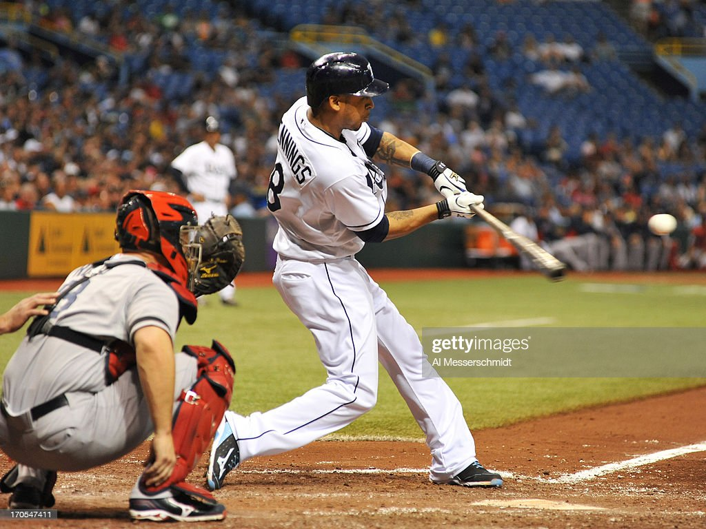 Outfielder <a gi-track='captionPersonalityLinkClicked' href=/galleries/search?phrase=Desmond+Jennings&family=editorial&specificpeople=5974085 ng-click='$event.stopPropagation()'>Desmond Jennings</a> #8 of the Tampa Bay Rays hits a home run in the 5th inning against the Boston Red Sox June 11, 2013 at Tropicana Field in St. Petersburg, Florida. Jennings also homered in the 2nd inning.
