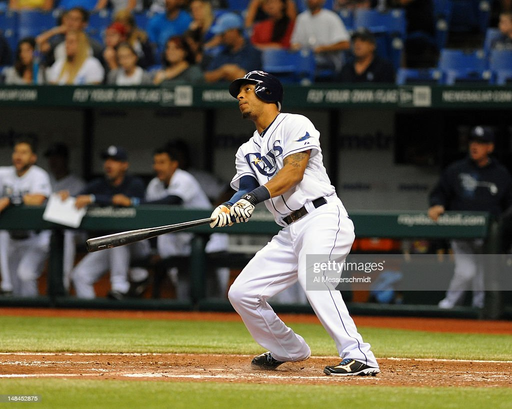 Outfielder <a gi-track='captionPersonalityLinkClicked' href=/galleries/search?phrase=Desmond+Jennings&family=editorial&specificpeople=5974085 ng-click='$event.stopPropagation()'>Desmond Jennings</a> #8 of the Tampa Bay Rays homers in the seventh inning against the Cleveland Indians July 16, 2012 at Tropicana Field in St. Petersburg, Florida.