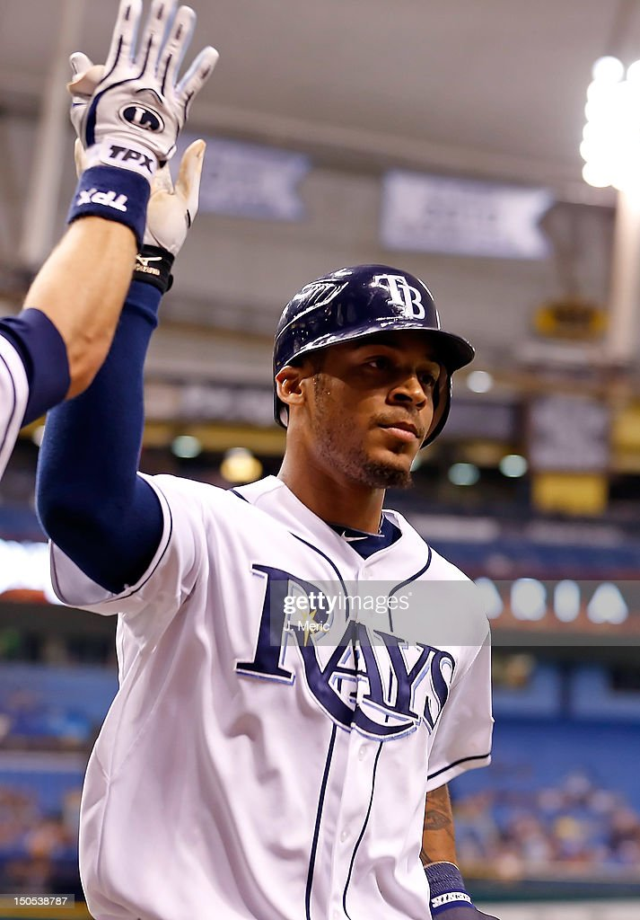 Outfielder <a gi-track='captionPersonalityLinkClicked' href=/galleries/search?phrase=Desmond+Jennings&family=editorial&specificpeople=5974085 ng-click='$event.stopPropagation()'>Desmond Jennings</a> #8 of the Tampa Bay Rays is congratulated after scoring against the Kansas City Royals during the game at Tropicana Field on August 20, 2012 in St. Petersburg, Florida.