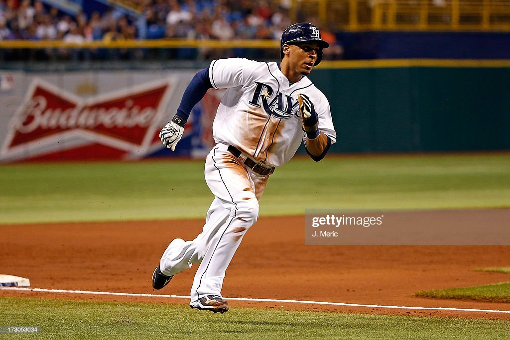 Outfielder <a gi-track='captionPersonalityLinkClicked' href=/galleries/search?phrase=Desmond+Jennings&family=editorial&specificpeople=5974085 ng-click='$event.stopPropagation()'>Desmond Jennings</a> #8 of the Tampa Bay Rays rounds third base on his way home in the second inning against the Chicago White Sox at Tropicana Field on July 5, 2013 in St. Petersburg, Florida.