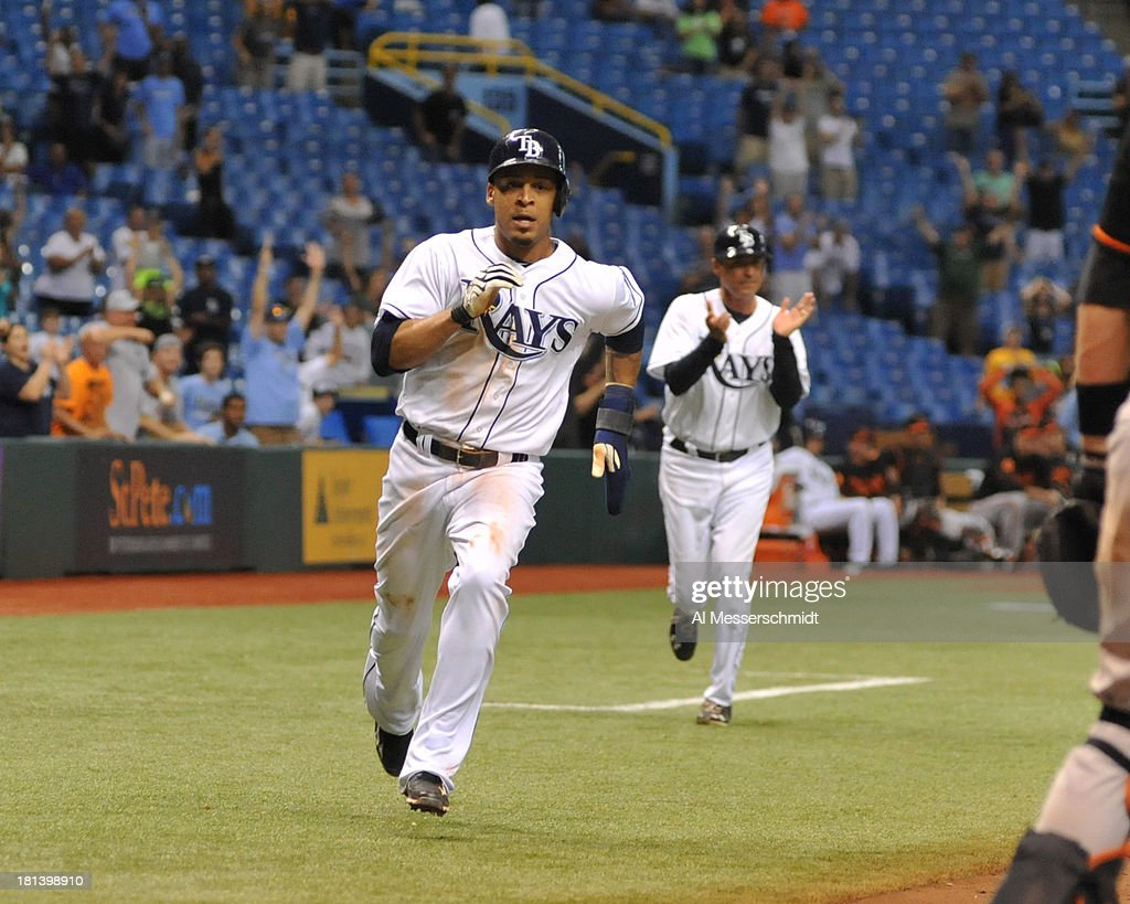 Outfielder Desmond Jennings #8 of the Tampa Bay Rays runs to home plate to score the winning run in the 18th inning against the Baltimore Orioles September 20, 2013 at Tropicana Field in St. Petersburg, Florida. The Rays won 5 - 4.