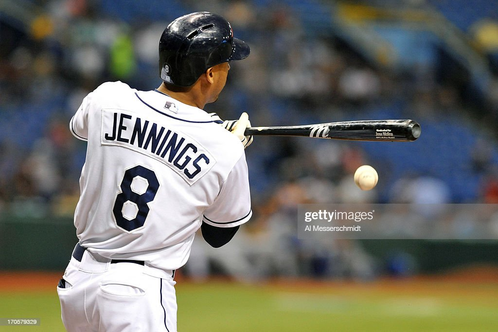 Outfielder <a gi-track='captionPersonalityLinkClicked' href=/galleries/search?phrase=Desmond+Jennings&family=editorial&specificpeople=5974085 ng-click='$event.stopPropagation()'>Desmond Jennings</a> #8 of the Tampa Bay Rays singles on an infield hit against the Kansas City Royals June 14, 2013 at Tropicana Field in St. Petersburg, Florida.
