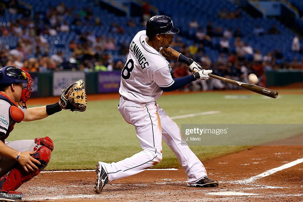 Outfielder <a gi-track='captionPersonalityLinkClicked' href=/galleries/search?phrase=Desmond+Jennings&family=editorial&specificpeople=5974085 ng-click='$event.stopPropagation()'>Desmond Jennings</a> #8 of the Tampa Bay Rays triples in the sixth inning against the Boston Red Sox during the game at Tropicana Field on September 19, 2012 in St. Petersburg, Florida.