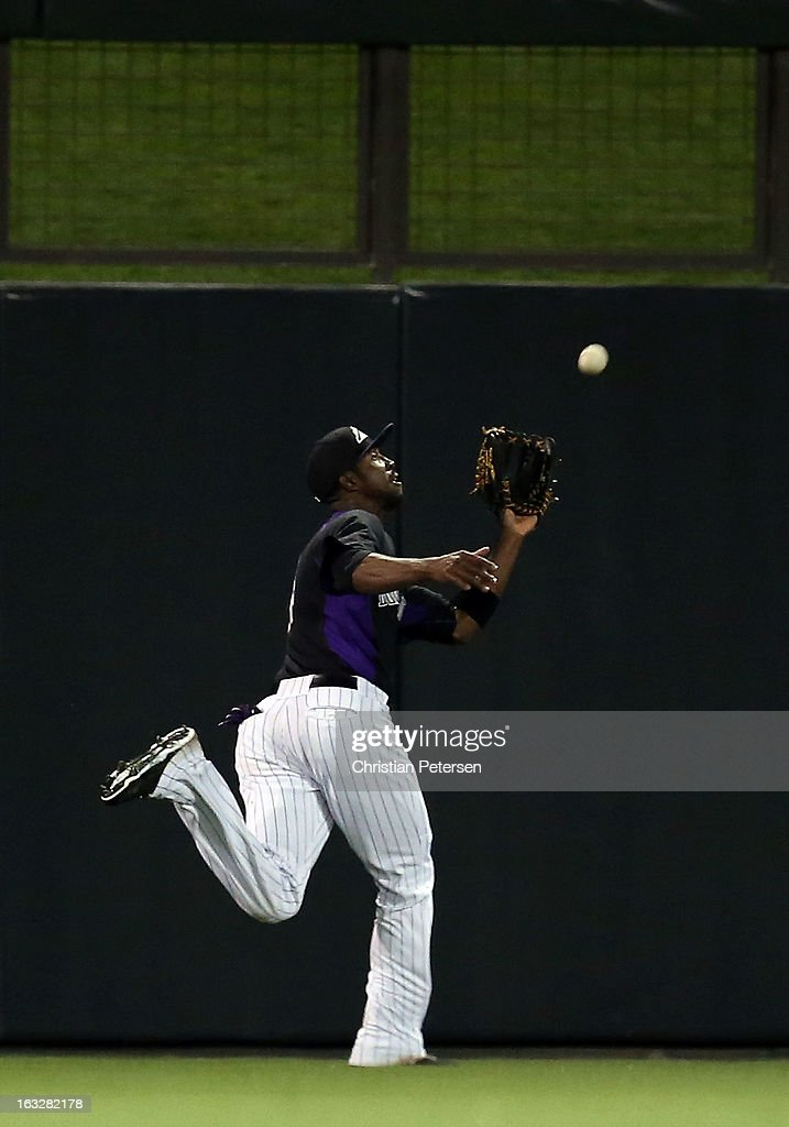 Outfielder <a gi-track='captionPersonalityLinkClicked' href=/galleries/search?phrase=Dexter+Fowler&family=editorial&specificpeople=4949024 ng-click='$event.stopPropagation()'>Dexter Fowler</a> #24 of the Colorado Rockies catches a fly ball out during the spring training game against Team USA at Salt River Fields at Talking Stick on March 6, 2013 in Scottsdale, Arizona.