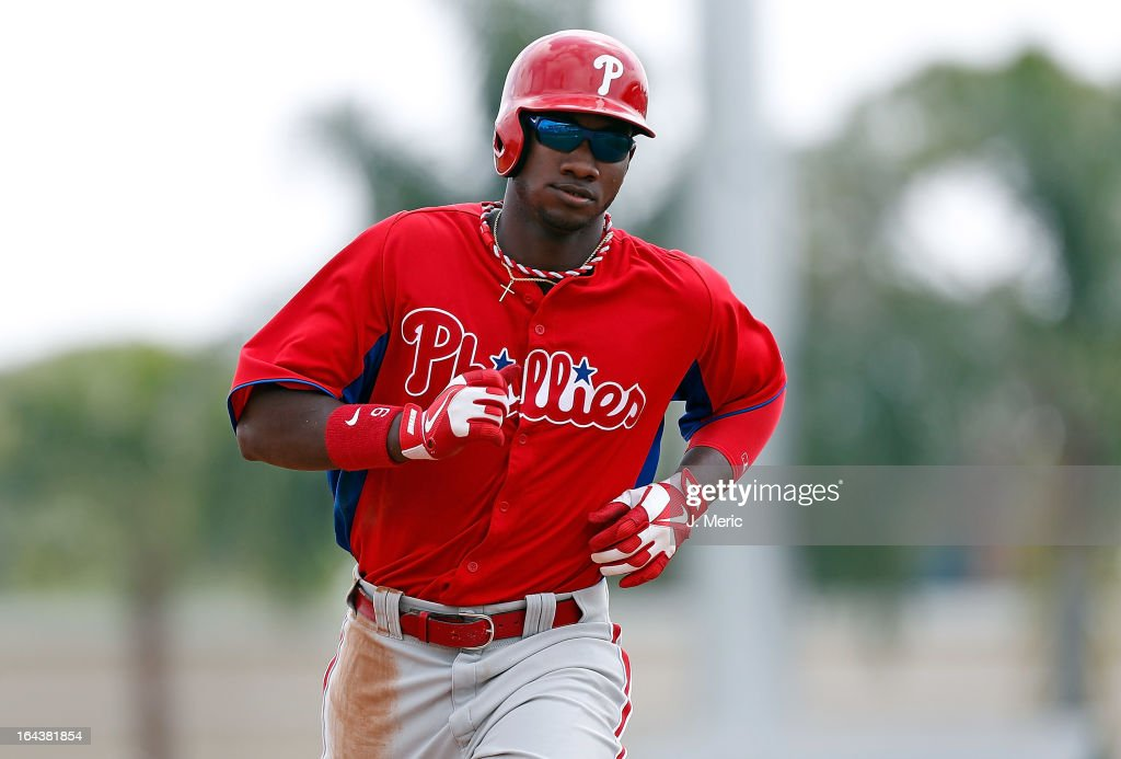 Outfielder Domonic Brown #9 of the Philadelphia Phillies rounds the bases after his three-run home run against the Baltimore Orioles during a Grapefruit League Spring Training Game at Ed Smith Stadium on March 23, 2013 in Sarasota, Florida.