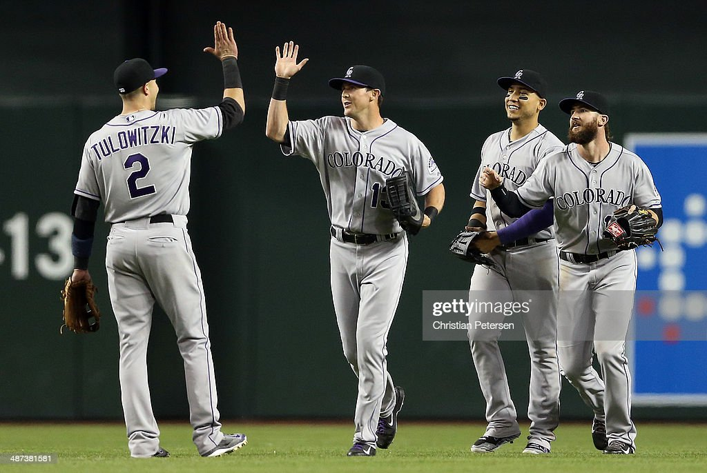 Outfielder <a gi-track='captionPersonalityLinkClicked' href=/galleries/search?phrase=Drew+Stubbs+-+Baseball+Player&family=editorial&specificpeople=4498334 ng-click='$event.stopPropagation()'>Drew Stubbs</a> #13 of the Colorado Rockies high fives <a gi-track='captionPersonalityLinkClicked' href=/galleries/search?phrase=Troy+Tulowitzki&family=editorial&specificpeople=757353 ng-click='$event.stopPropagation()'>Troy Tulowitzki</a> #2 after defeating the Arizona Diamondbacks in the MLB game at Chase Field on April 29, 2014 in Phoenix, Arizona. The Rockies defeated the Diamondbacks 5-4.