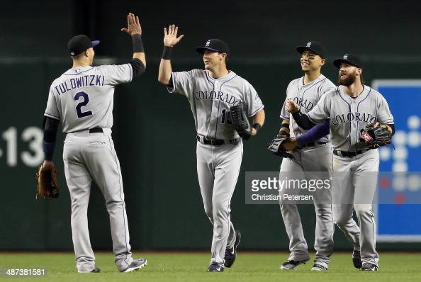 Outfielder Drew Stubbs of the Colorado Rockies highfives Troy Tulowitzki after defeating the Arizona Diamondbacks in the MLB game at Chase Field on...