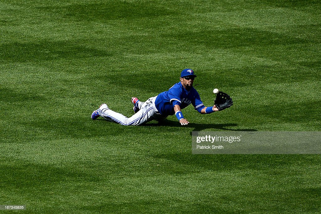Outfielder Emilio Bonifacio #1 of the Toronto Blue Jays makes an diving catch and out on batter Ryan Flaherty #3 of the Baltimore Orioles (not pictured) in the eleventh inning at Oriole Park at Camden Yards on April 24, 2013 in Baltimore, Maryland. The Toronto Blue Jays won, 6-5.