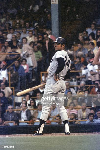 Outfielder Felipe Alou of the New York Yankees looks towards the thirdbase coach for the next sign in an at bat during a game in July 1971 against...