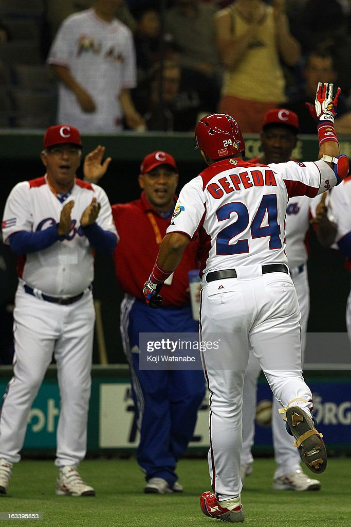 Outfielder Frederich Cepeda #24 of Cuba celebrates after hits a two run home run in the top half of the first inning during the World Baseball Classic Second Round Pool 1 game between Chinese Taipei and Cuba at Tokyo Dome on March 9, 2013 in Tokyo, Japan.