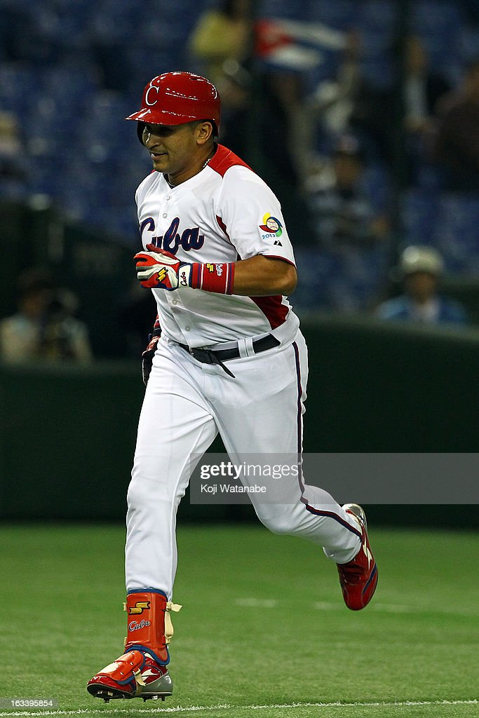 Outfielder <a gi-track='captionPersonalityLinkClicked' href=/galleries/search?phrase=Frederich+Cepeda&family=editorial&specificpeople=801641 ng-click='$event.stopPropagation()'>Frederich Cepeda</a> #24 of Cuba celebrates after hits a two run home run in the top half of the first inning during the World Baseball Classic Second Round Pool 1 game between Chinese Taipei and Cuba at Tokyo Dome on March 9, 2013 in Tokyo, Japan.