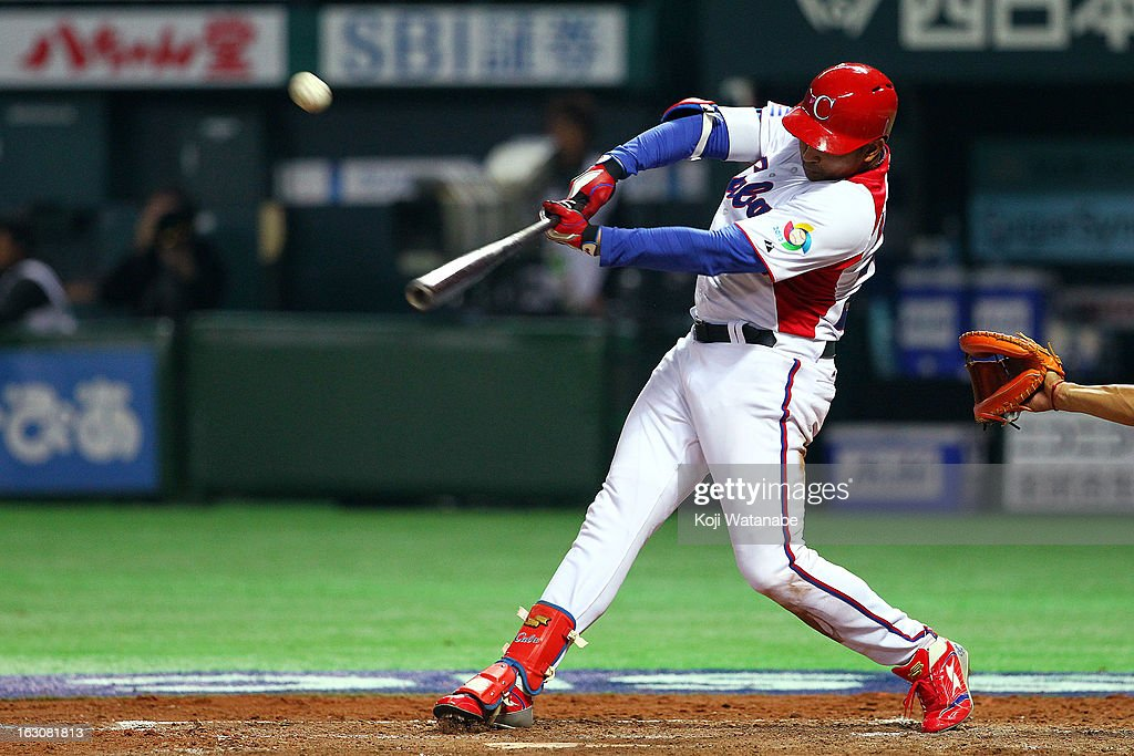 Outfielder Frederich Cepeda #24 of Cuba hits a double in the bottom half of the fourth inning during the World Baseball Classic First Round Group A game between Cuba and China at Fukuoka Yahoo! Japan Dome on March 4, 2013 in Fukuoka, Japan.
